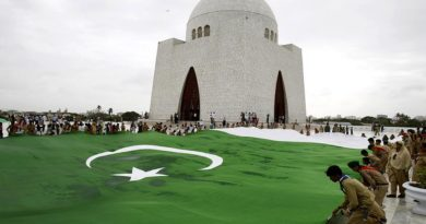 Students hold a giant representation of a Pakistani flag to celebrate the 68th Independence Day at the mausoleum of  Muhammad Ali Jinnah, founder of Pakistan in Karachi, Pakistan, Thursday, Aug. 14, 2014. Pakistanis commemorated its independence from British colonial rule. (AP Photo/Fareed Khan)