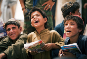 Wali Muhammad and other Afghan boys call out the letter their teacher points to during class at the Forward Operating Base Geronimo schoolhouse in Afghanistan, July 8. Most of the kids who attend school are younger than the current war. The children are taught by Marine, Navy and Afghan volunteers.