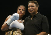 Boxer Laila Ali poses with her father, former heavyweight champion Muhammad Ali, after she defeated Suzy Taylor in two rounds at the Aladdin Casino in Las Vegas, Nevada, August 17, 2002 (Photo By Scott Halleran/Getty Images)
