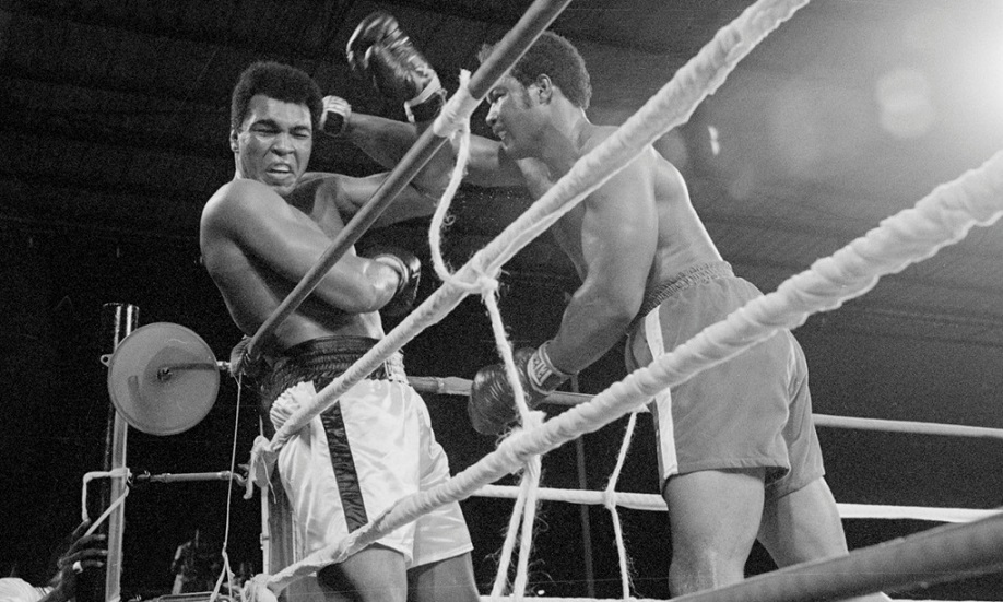 George Foreman Punching Muhammad Ali by the Ropes