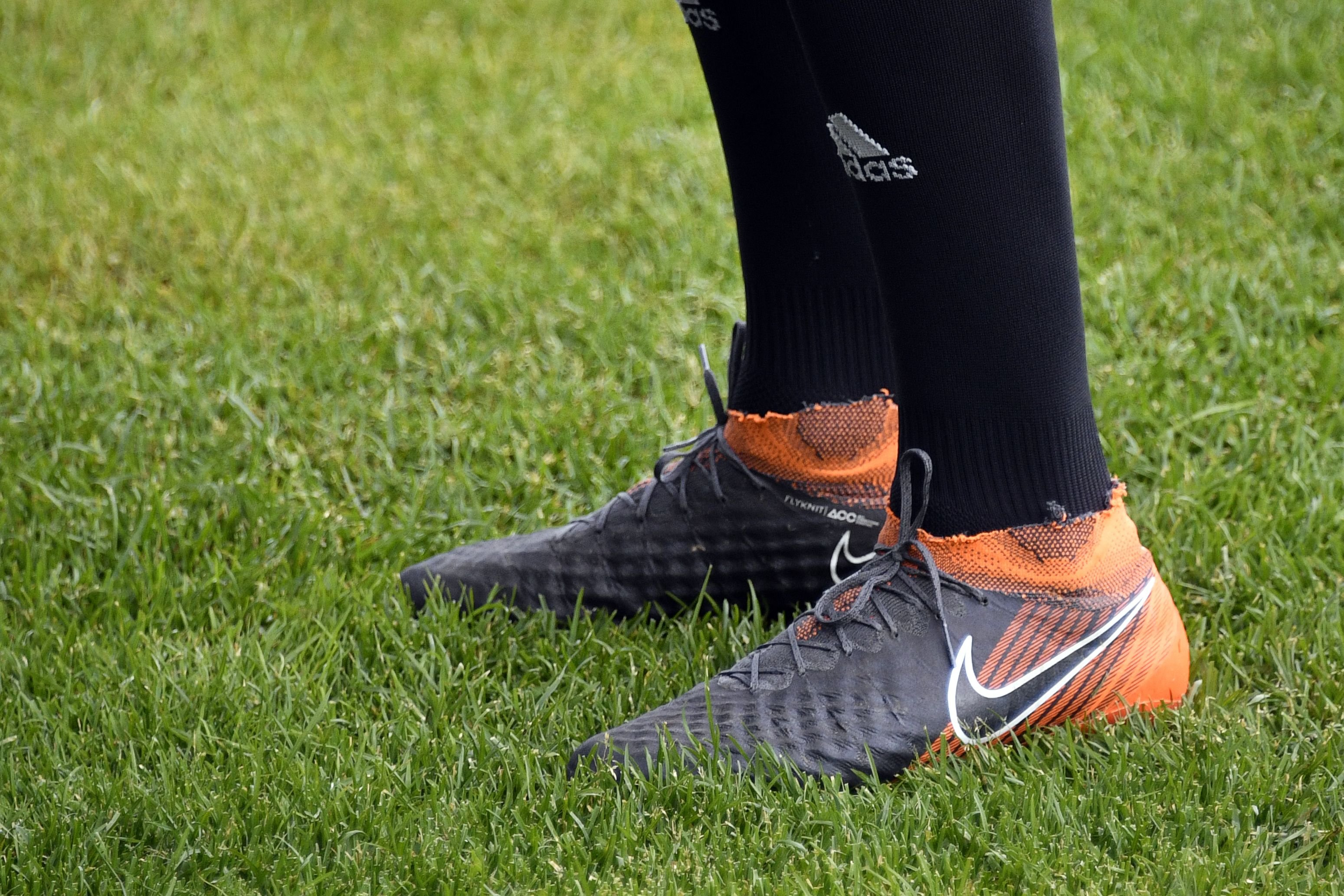 A picture taken on 14 June 2018 shows the football shoes of Iran's midfielder Saeid Ezatolahi upon his arrival to take part in a training session in Bakovka, outside Moscow, ahead of the Russia 2018 World Cup.