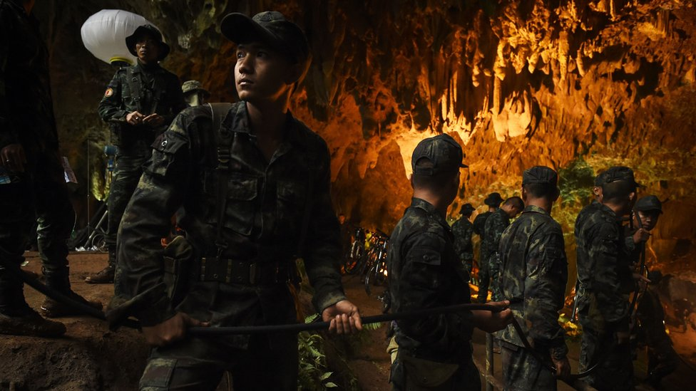 Soldiers relaying electric cables into the cave system