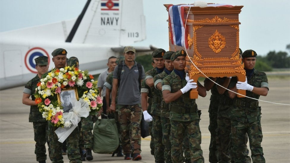 Saman Gunan's coffin is carried by soldiers