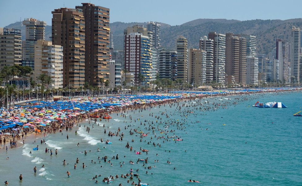 People cool off at the beach during the heatwave in the southeastern coastal town of Benidorm