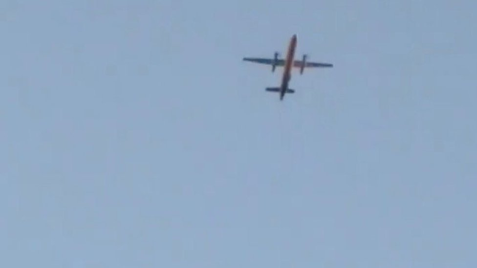 A Horizon Air Bombardier Dash 8 Q400, reported to be hijacked, flies over Fircrest, Washington, the U.S., before crashing in the South Puget Sound,