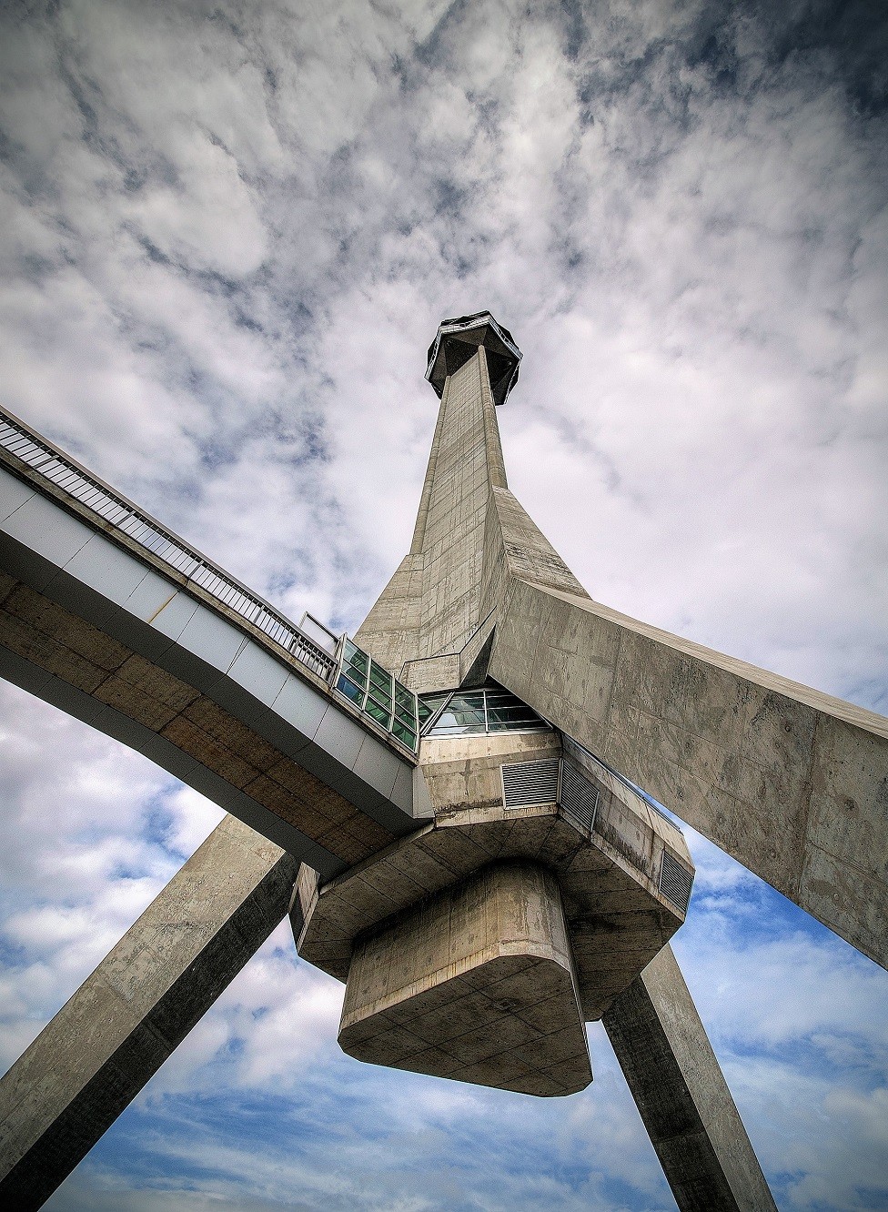 A concrete tower building in the shape of a tripod