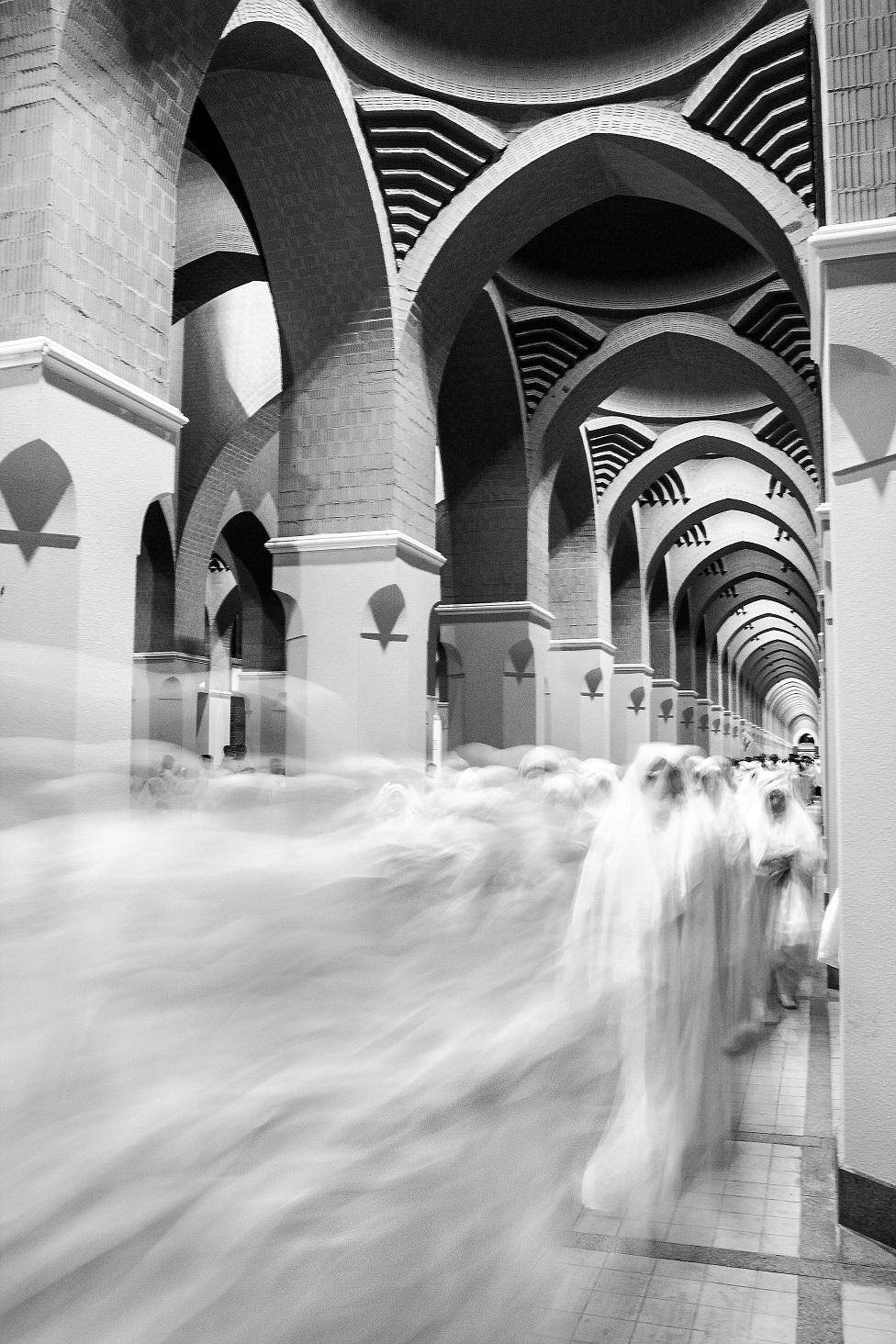 A long exposure photo of women walking down a corridor