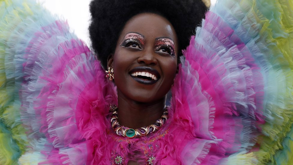 Lupita Nyong'o smiles