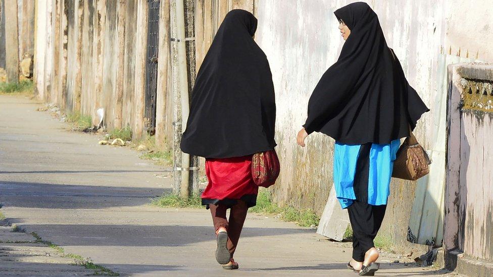 In this picture taken on April 25, 2019, Sri Lankan Muslim girls walk along a road in Kattankudy