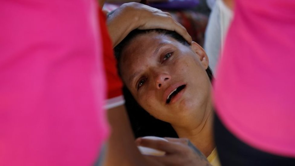 A relative of a prisoner cries in front of the Medical Legal Institute of Altamira, Brazil, July 30, 2019.