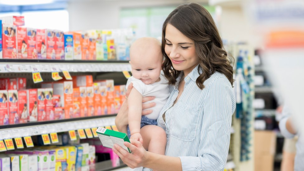Mother shopping with a baby
