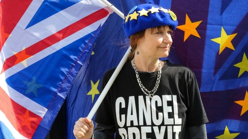 Woman with EU and UK flags