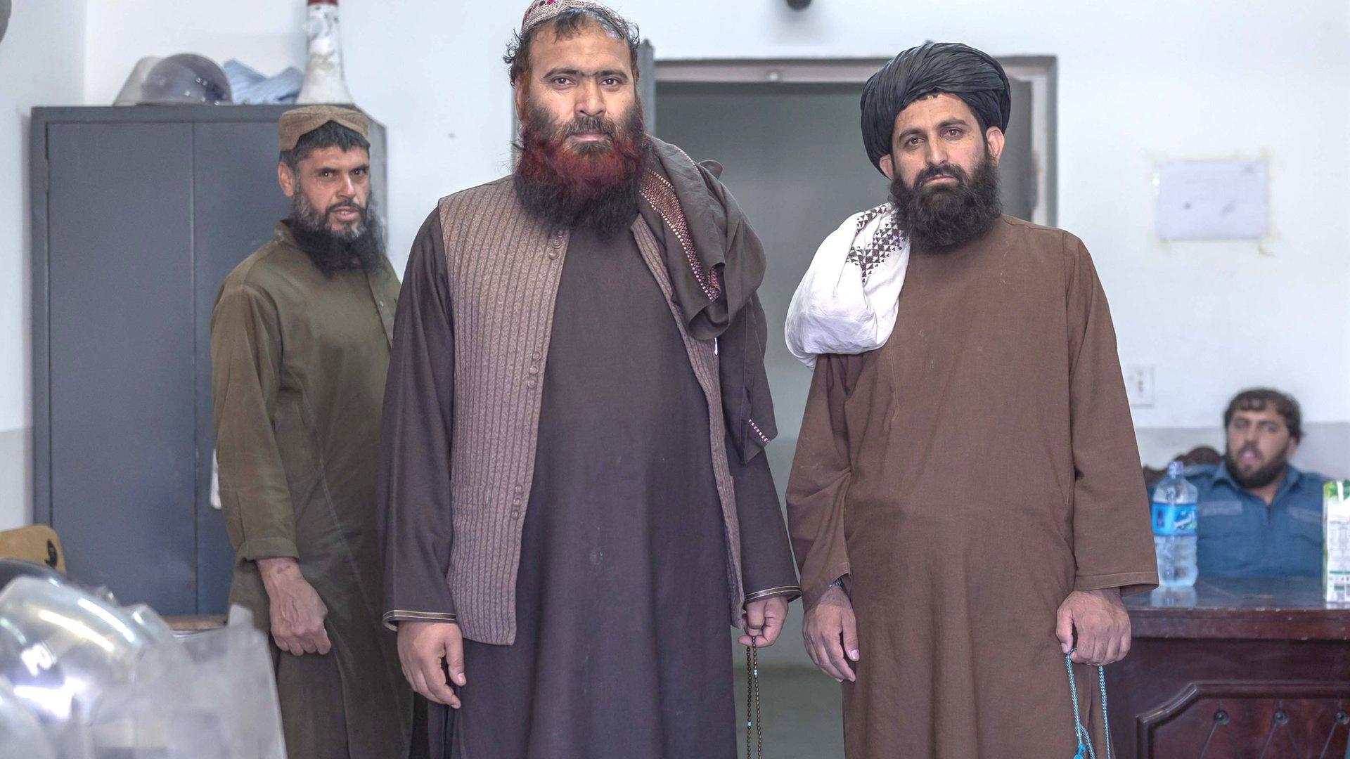 Mawlawi Fazel Bari (right) with another Taliban prisoner