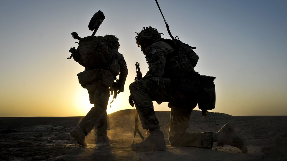 British soldiers on dawn foot patrol in Nahr-e Saraj district, Helmand Province, Afghanistan