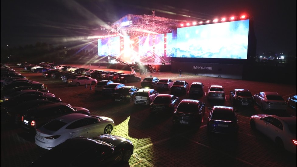 Cars are parked at a drive-in musical operation by Hyundai Motor at Stage X Drive-in Concert as South Koreans take measures to protect themselves against the spread of coronavirus