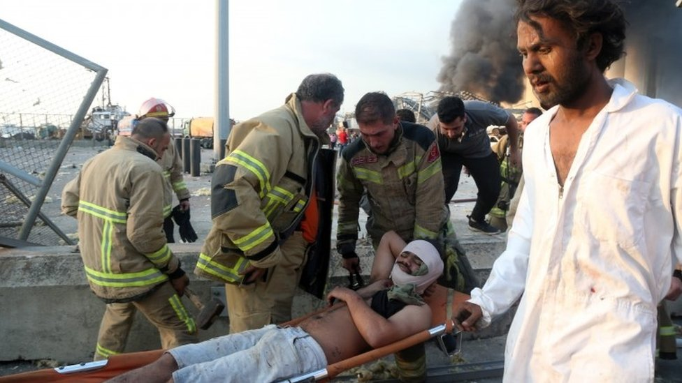 An injured man is evacuated from the scene
