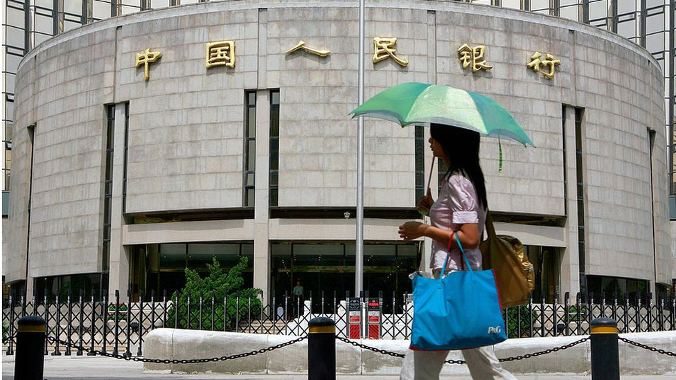 A pedestrian walks past the People's Bank of China