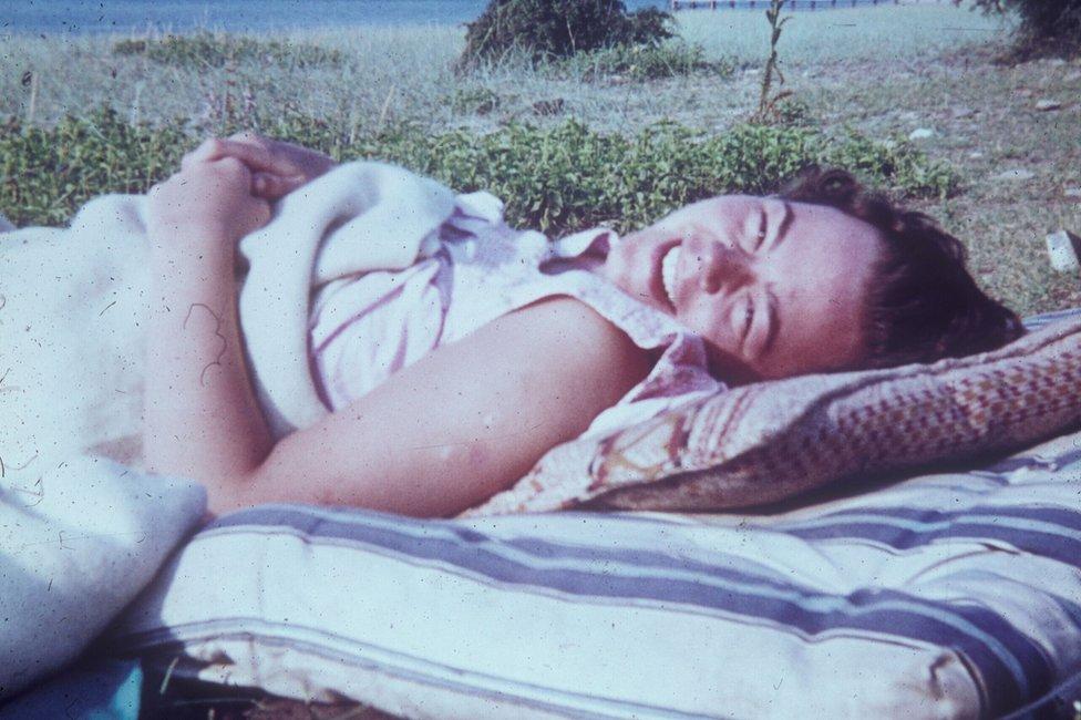 Wendy Scott lying on a mattress on the beach by the Black Sea