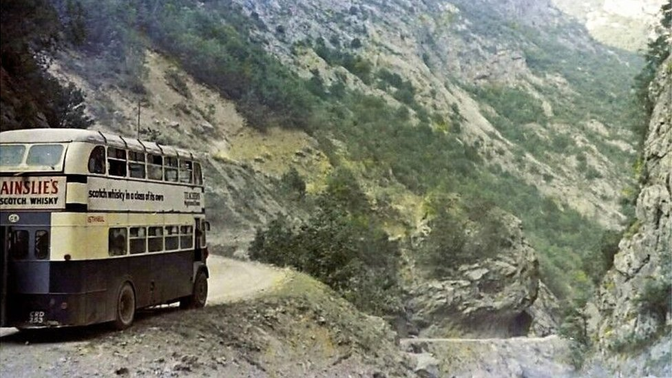 The bus on the very edge of the road on the Cakor Pass, Yugoslavia (Montenegro)