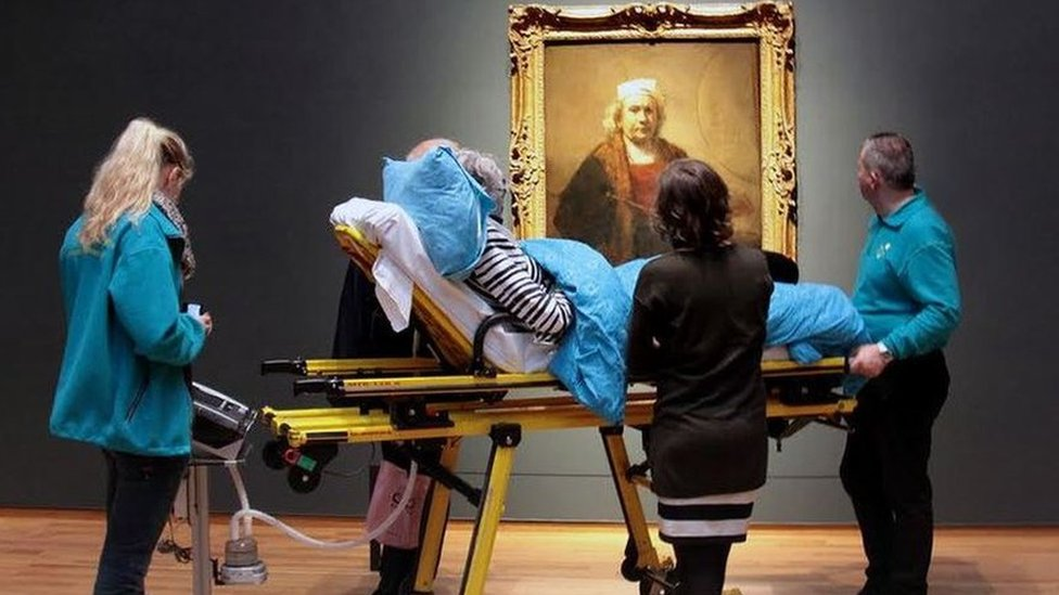 A patient being taken to a museum