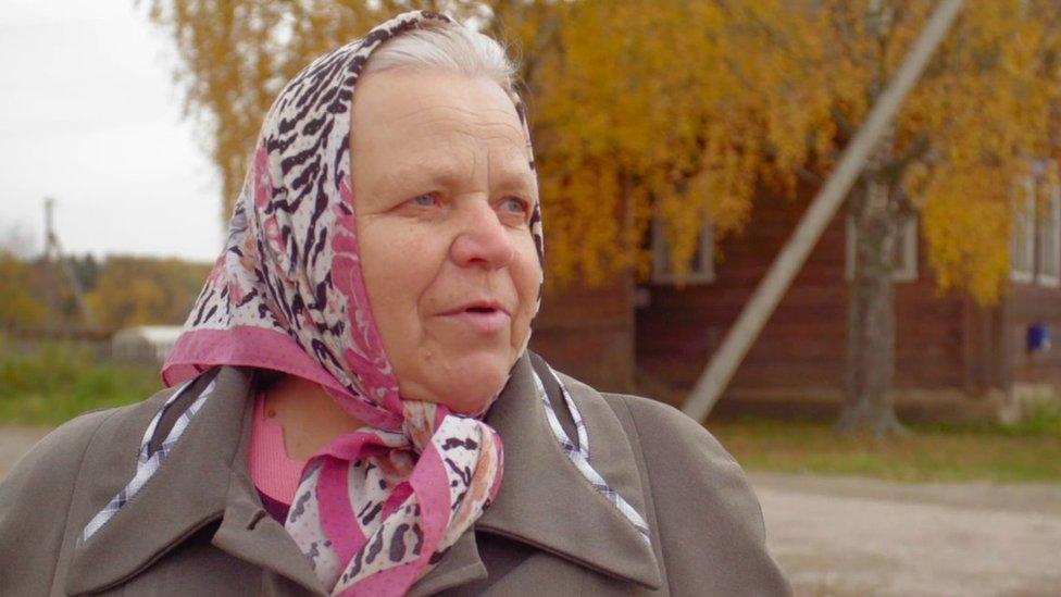 A woman who supports Udgodskaya speaks to the camera