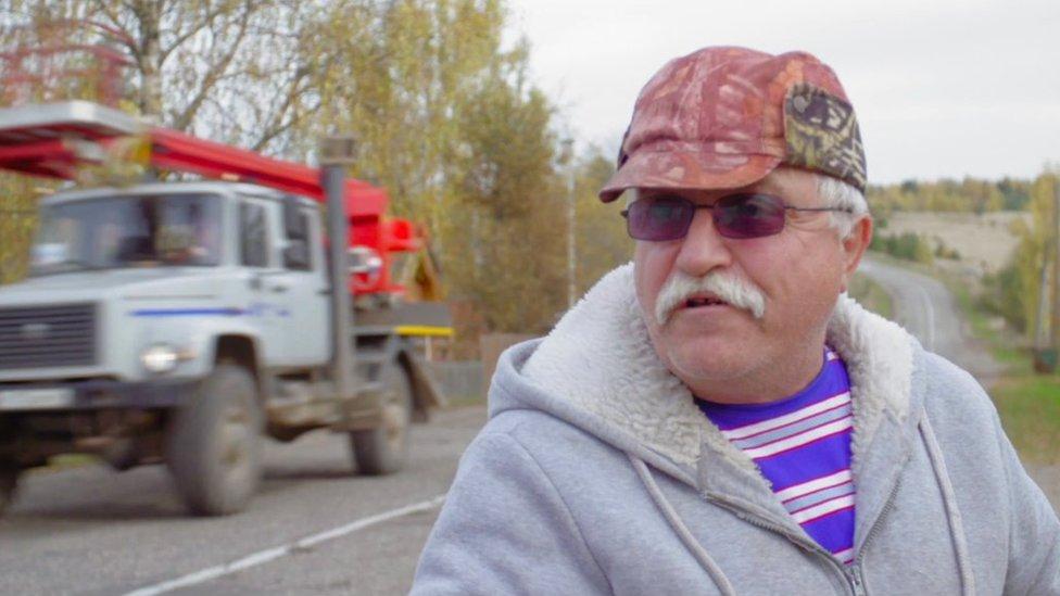 An Udgodskaya supporter stands by a roadside
