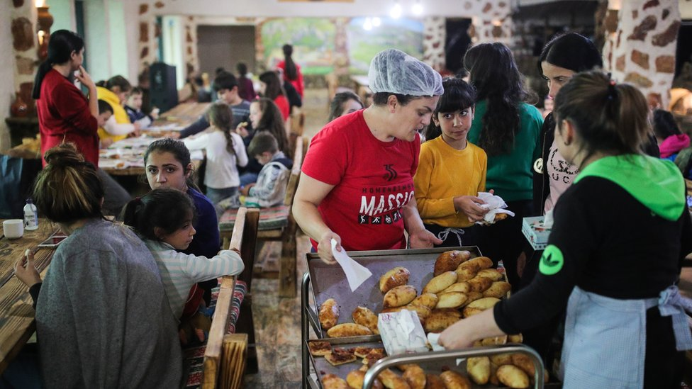 Refugees from Nagorno-Karabakh have their meals at a hotel in the Armenian town of Goris