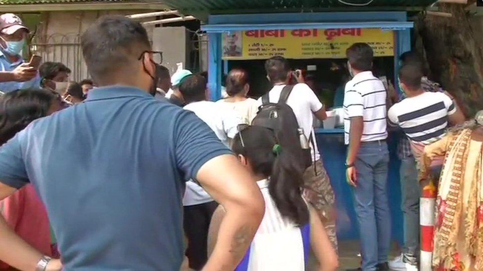 Lines of people waiting to buy Mr Prasad's food