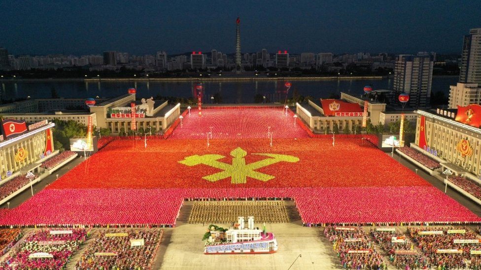 People take part in a procession to commemorate the 75th anniversary of the founding of the ruling Workers' Party