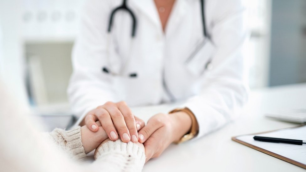 Female doctor with patient, file pic