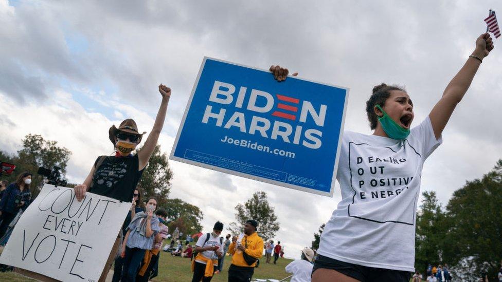 People celebrate Joe Biden's projected presidential win at Freedom Park on November 7, 2020 in Atlanta, Georgia