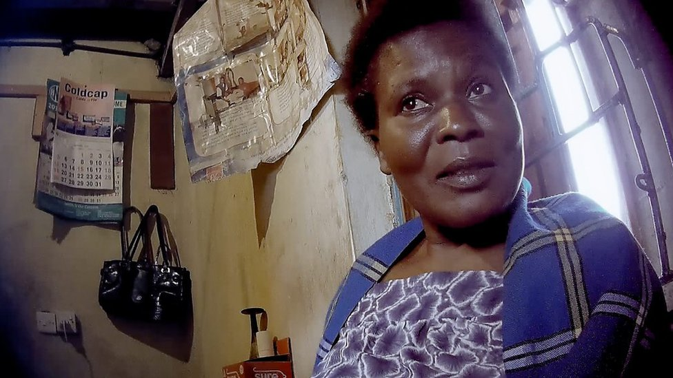 Mary Auma negotiates a sale at her street clinic