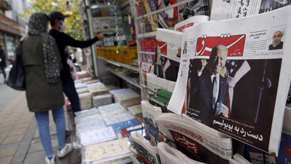 A copy of Iranian daily newspaper Shargh, with a picture of US president-elect Joe Biden and headline