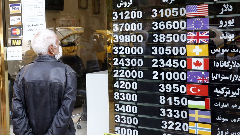 A man checks currency exchange rates in Tehran, Iran (14 October 2020)
