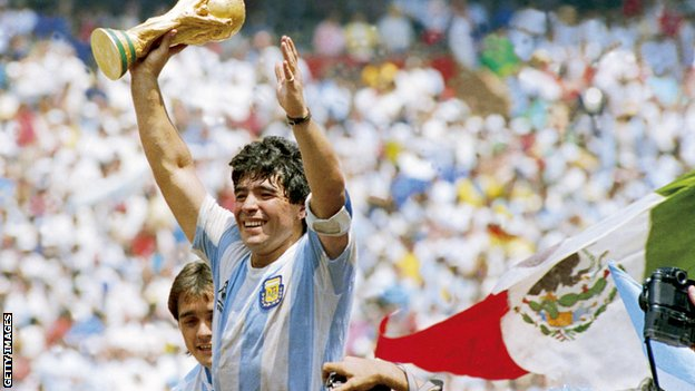 Diego Maradona holds up the World Cup trophy