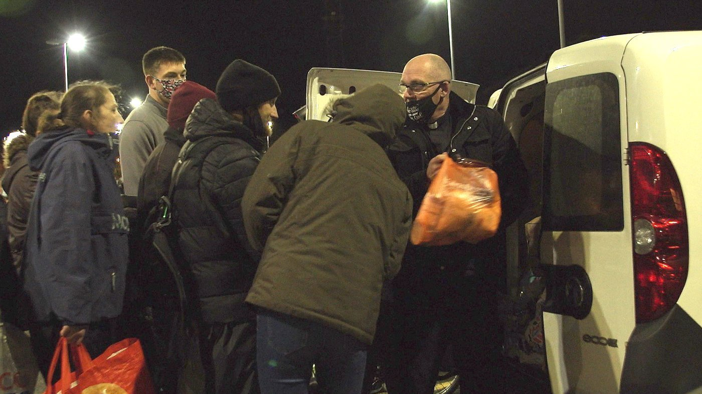 Pastor Mick Fleming hands out food