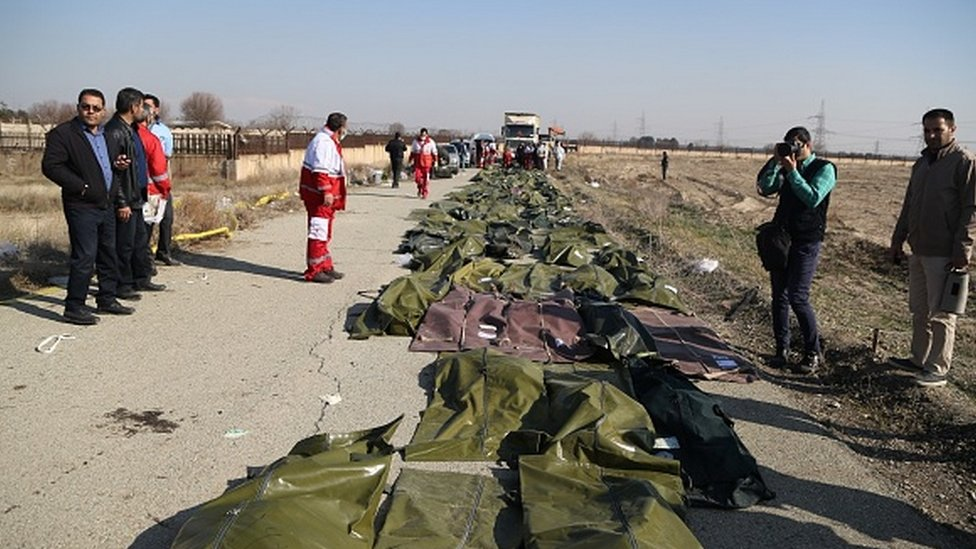 The bodies of those killed at the crash site