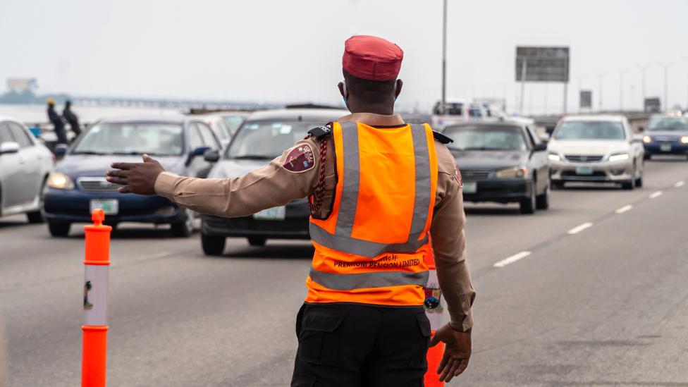 Someone directing traffic on the Third Mainland Bridge, Lagos, Nigeria