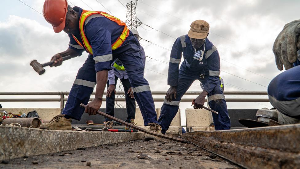 Workers doing repairs on the Third Mainland Bridge in Lagos, Nigeria