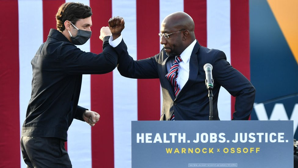 Jon Ossoff and Raphael Warnock at a rally