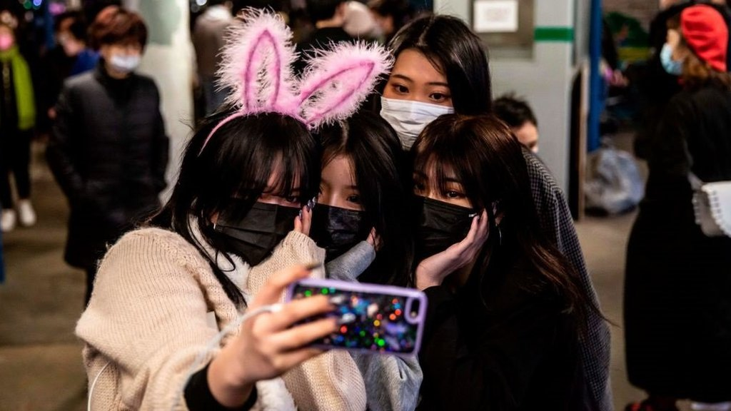 Chinese women posing for a photo