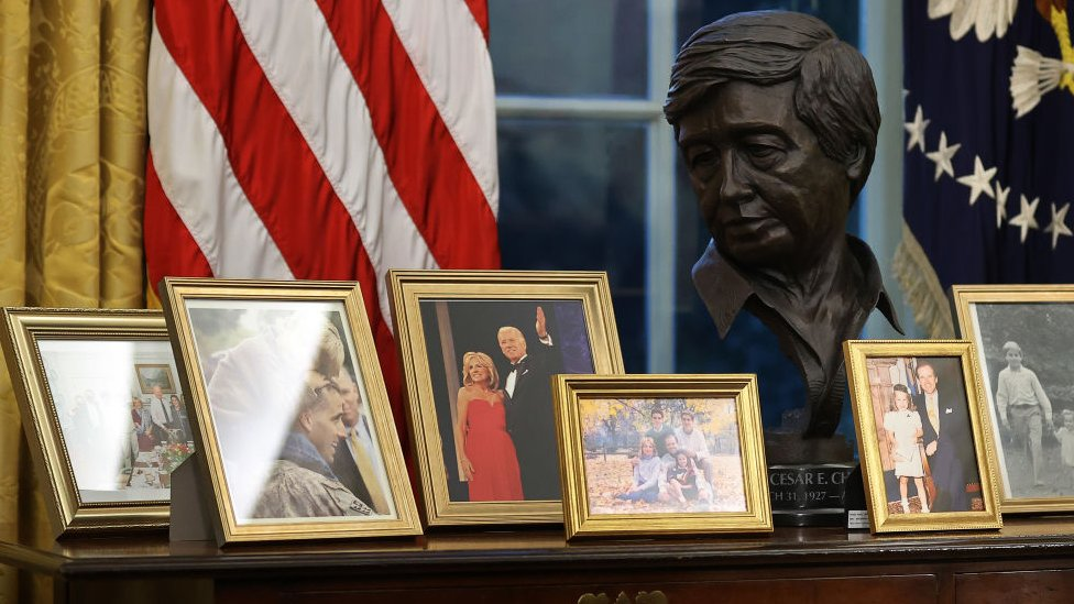 Bust of Cezar Chavez alongside family pictures in Biden's office on 20 January 2021