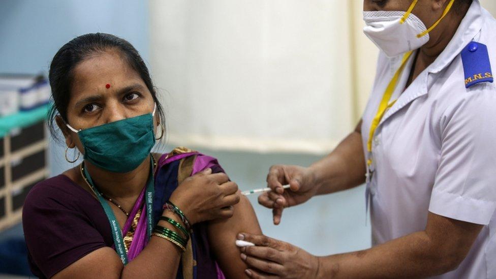 A woman gets a vaccines at Rajawadi Hospital in Mumbai, India