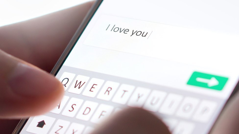 Phone with 'I love you' message