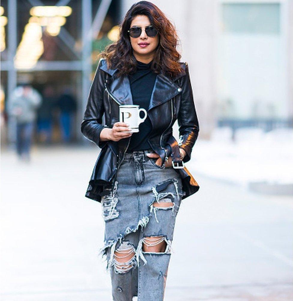 Bollywood actress Priyanka Chopra in a pair of ripped jeans