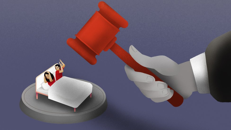 Illustration of couple in bed with a judges gavel coming down on them.