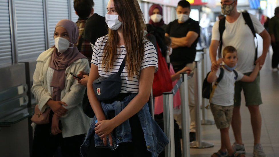 Newly-arrived passengers from California and Turkey wait to be tested for coronavirus (COVID-19) at Tegel (TXL) airport on July 29, 2020 in Berlin, Germany.