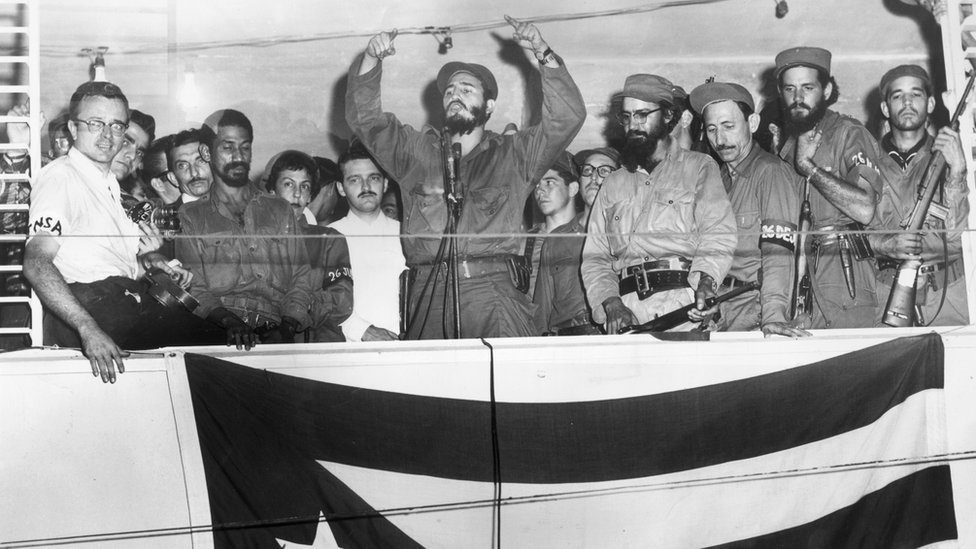 Cuban President Fidel Castro speaking from a podium to the people of Camaguey, Cuba about the Triumph of the Cuban Revolution
