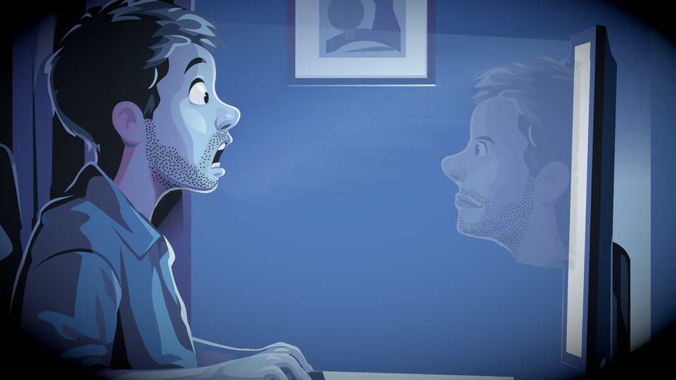 man sees himself on screen