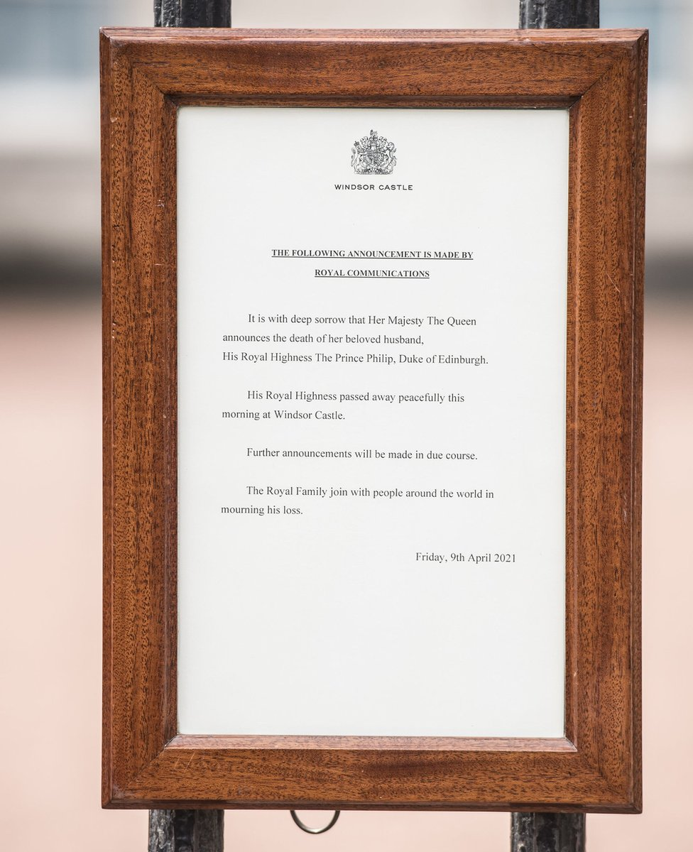 A notice announcing Prince Philip's death attached to the gates at Buckingham Palace